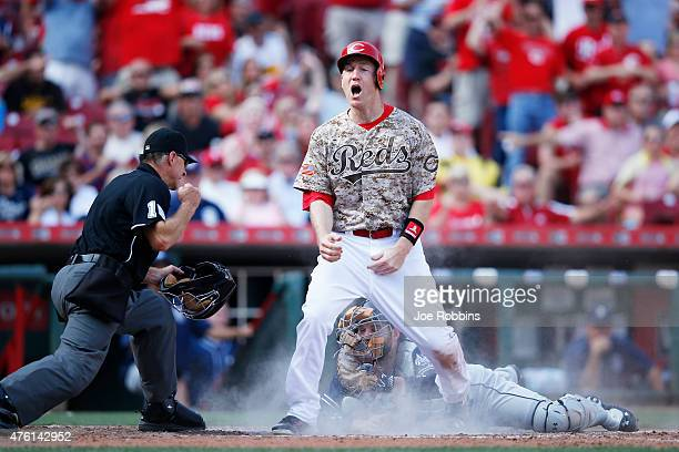 Todd Frazier of the Cincinnati Reds reacts after being thrown out at home plate in the sixth inning of the game against the San Diego Padres at Great...
