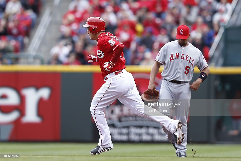<a gi-track='captionPersonalityLinkClicked' href=/galleries/search?phrase=Todd+Frazier&family=editorial&specificpeople=4778756 ng-click='$event.stopPropagation()'>Todd Frazier</a> #21 of the Cincinnati Reds rounds the bases after hitting a home run to left in the second inning of the game against the Los Angeles Angels of Anaheim at Great American Ball Park on April 4, 2013 in Cincinnati, Ohio.