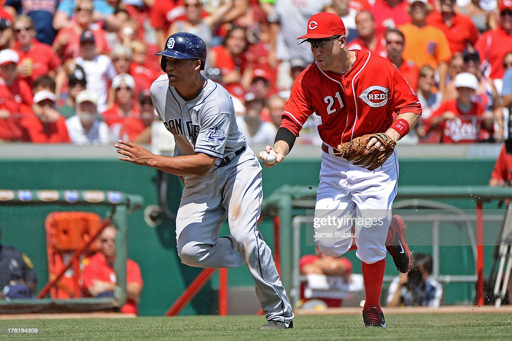 <a gi-track='captionPersonalityLinkClicked' href=/galleries/search?phrase=Todd+Frazier&family=editorial&specificpeople=4778756 ng-click='$event.stopPropagation()'>Todd Frazier</a> #21 of the Cincinnati Reds runs down and tags out <a gi-track='captionPersonalityLinkClicked' href=/galleries/search?phrase=Will+Venable&family=editorial&specificpeople=3068470 ng-click='$event.stopPropagation()'>Will Venable</a> #25 of the San Diego Padres in the seventh inning after Venable tried to score from third base on an infield hit at Great American Ball Park on August 11, 2013 in Cincinnati, Ohio. Cincinnati defeated San Diego 3-2 in 13 innings.