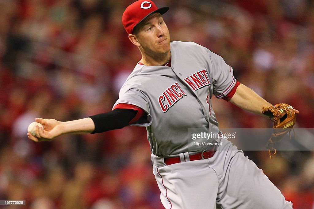 <a gi-track='captionPersonalityLinkClicked' href=/galleries/search?phrase=Todd+Frazier&family=editorial&specificpeople=4778756 ng-click='$event.stopPropagation()'>Todd Frazier</a> #21 of the Cincinnati Reds throws out a runner at first base against the St. Louis Cardinals at Busch Stadium on April 29, 2013 in St. Louis, Missouri. The Reds beat the Cardinals 2-1.