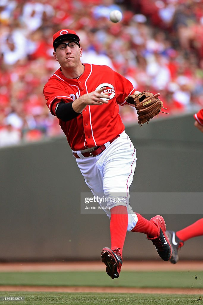 <a gi-track='captionPersonalityLinkClicked' href=/galleries/search?phrase=Todd+Frazier&family=editorial&specificpeople=4778756 ng-click='$event.stopPropagation()'>Todd Frazier</a> #21 of the Cincinnati Reds throws out Chase Headley #7 of the San Diego Padres in the fifth inning after making a bare handed grab of the ball at Great American Ball Park on August 11, 2013 in Cincinnati, Ohio. Cincinnati defeated San Diego 3-2 in 13 innings.