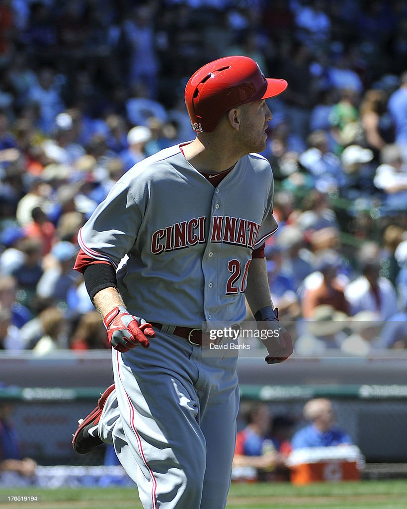 <a gi-track='captionPersonalityLinkClicked' href=/galleries/search?phrase=Todd+Frazier&family=editorial&specificpeople=4778756 ng-click='$event.stopPropagation()'>Todd Frazier</a> #21 of the Cincinnati Reds watches his home run against the Chicago Cubs during the first inning on August 14, 2013 at Wrigley Field in Chicago, Illinois.