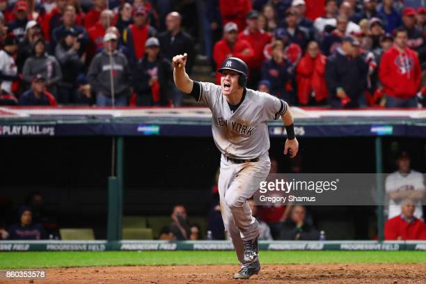 Todd Frazier of the New York Yankees celebrates after scoring on a single by Brett Gardner in the ninth inning against the Cleveland Indians in Game...