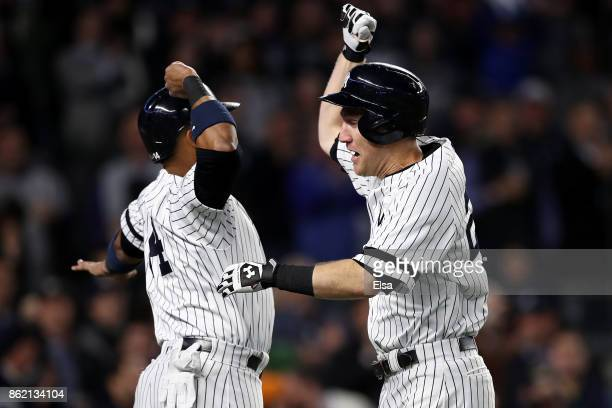 Todd Frazier of the New York Yankees celebrates hitting a 3run home run with teammate Starlin Castro against the Houston Astros during the second...