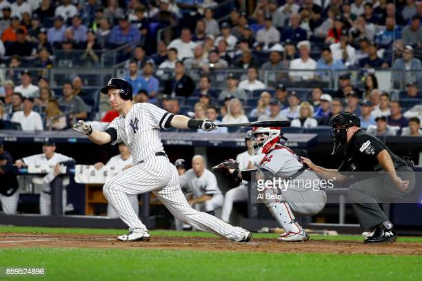 Todd Frazier of the New York Yankees hits a double to left field to score Starlin Castro against Trevor Bauer of the Cleveland Indians during the...