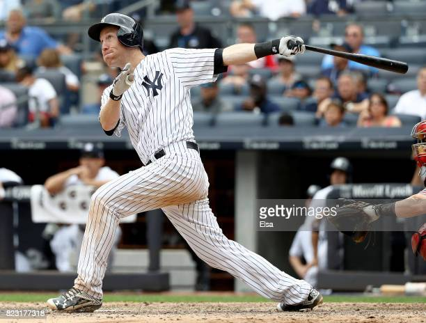 Todd Frazier of the New York Yankees hits a solo home run in the seventh inning against the Cincinnati Reds on July 26 2017 at Yankee Stadium in the...