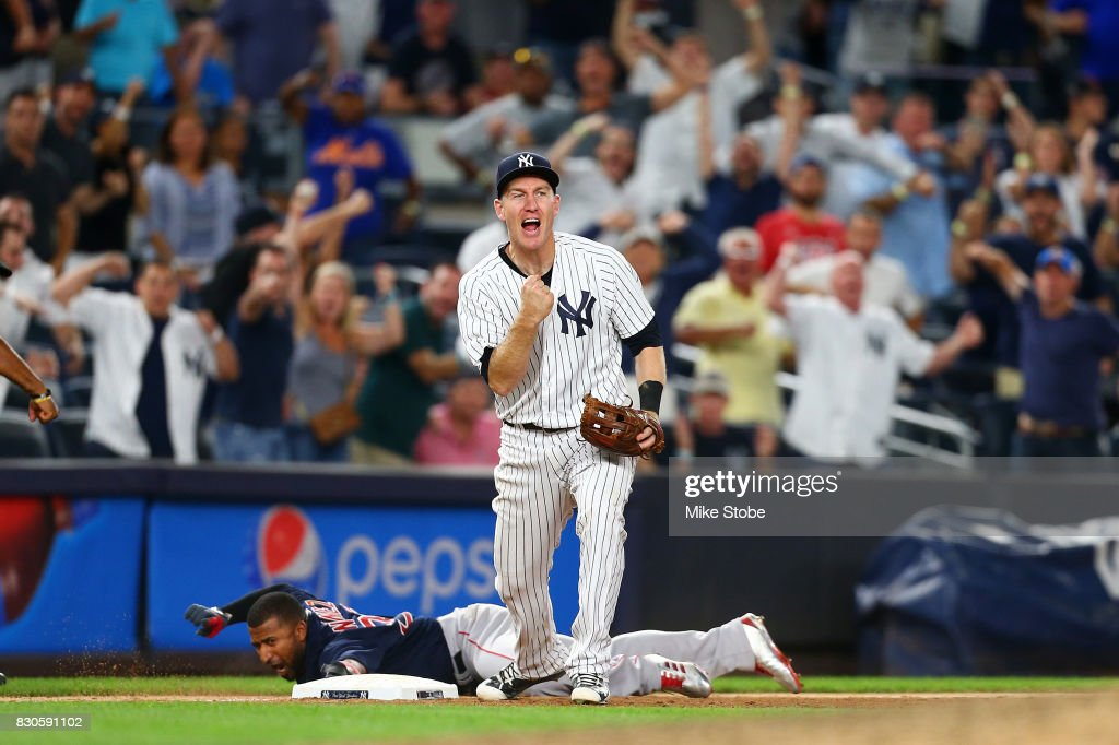 Todd Frazier #29 of the New York Yankees pumps his fist after tagging out Eduardo Nunez #36 of the Boston Red Sox for a double play in the ninth inning at Yankee Stadium on August 11, 2017 in the Bronx borough of New York City.