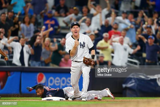 Todd Frazier of the New York Yankees pumps his fist after tagging out Eduardo Nunez of the Boston Red Sox for a double play in the ninth inning at...