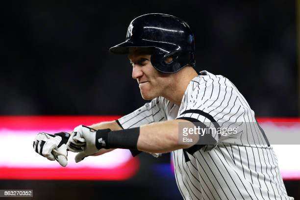 Todd Frazier of the New York Yankees reacts after a single in the eighth inning against the Houston Astros during Game Four of the American League...
