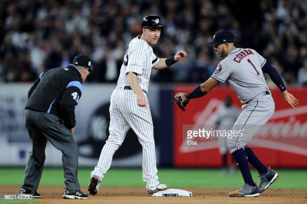 Todd Frazier of the New York Yankees reacts during the fourth inning as Carlos Correa of the Houston Astros applies a tag in Game Three of the...