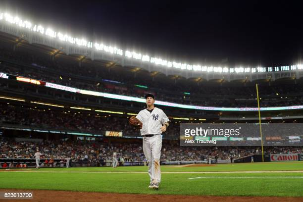 Todd Frazier of the New York Yankees returns to the dugout during the game against the Cincinnati Reds at Yankee Stadium on Tuesday July 2017 in the...