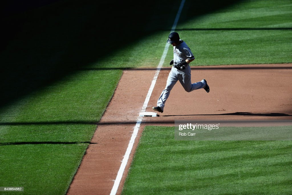 Todd Frazier #29 of the New York Yankees rounds the bases after hitting a solo home run against the Baltimore Orioles in the seventh inning at Oriole Park at Camden Yards on September 7, 2017 in Baltimore, Maryland.
