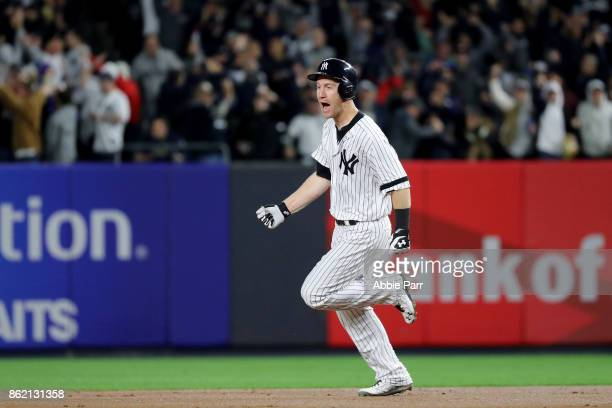 Todd Frazier of the New York Yankees rounds the bases after hitting a 3run home run against the Houston Astros during the second inning in Game Three...