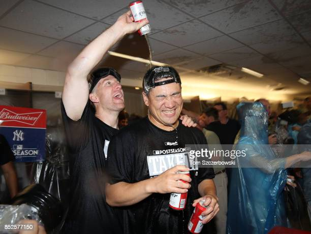 Todd Frazier of the New York Yankees sprayed Masahiro Tanaka as they celebrate their playoffclinching victory during MLB game action against the...