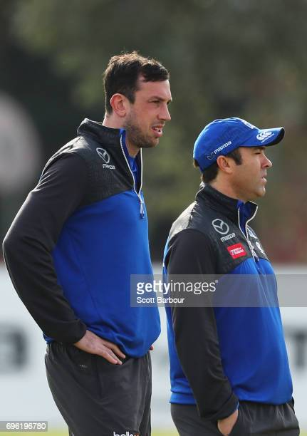 Todd Goldstein and Brad Scott coach of the Kangaroos talk during a North Melbourne Kangaroos AFL training session at Arden Street Ground on June 15...