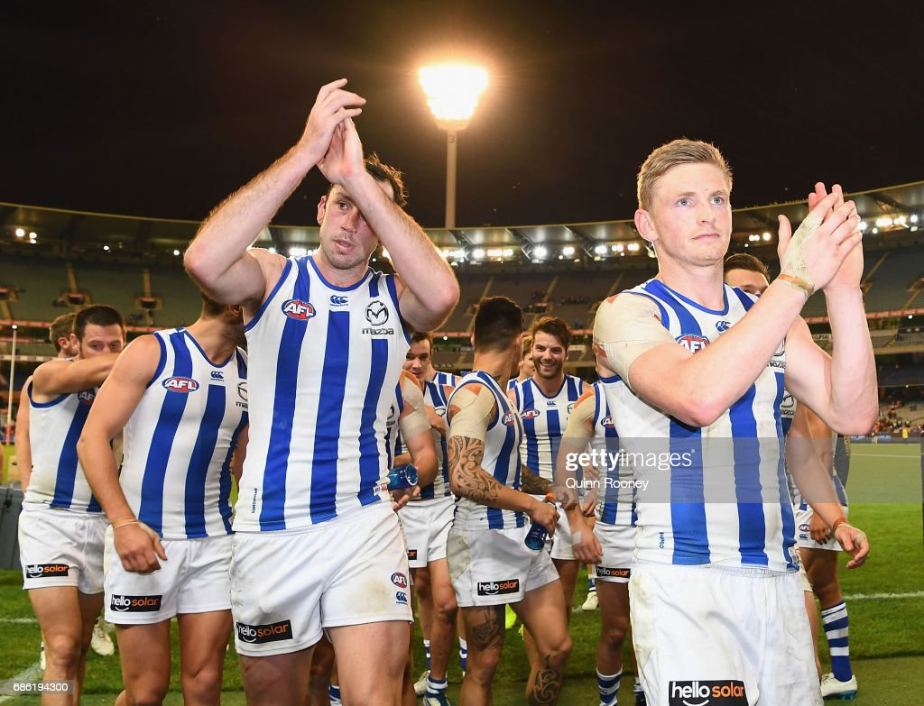 Todd Goldstein and Jack Ziebell of the Kangaroos celebrate winning the round nine AFL match between the Melbourne Demons and the North Melbourne Kangaroos at Melbourne Cricket Ground on May 21, 2017 in Melbourne, Australia.