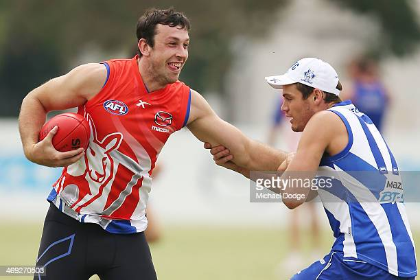 Todd Goldstein gets tackled by Nathan Grima during a North Melbourne Kangaroos AFL training session at Arden Street Ground on February 14 2014 in...