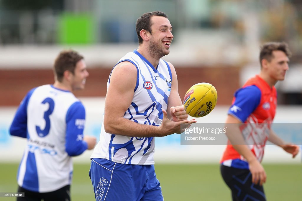 Todd Goldstein handballs during a North Melbourne Kangaroos AFL media session at Arden Street Ground on July 16 2014 in Melbourne Australia
