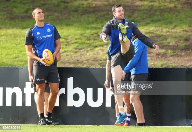 Todd Goldstein kicks the ball as Braydon Preuss of the Kangaroos looks on during a North Melbourne Kangaroos AFL training session at Arden Street...
