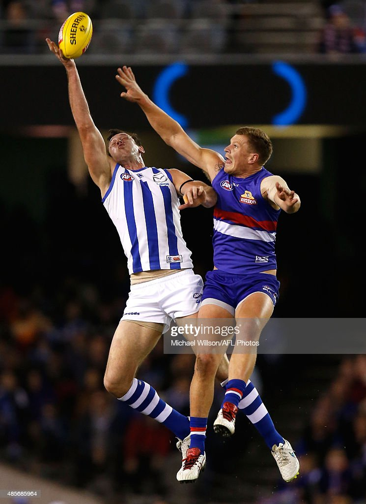 Todd Goldstein of the Kangaroos and Jack Redpath of the Bulldogs compete in a ruck contest during the 2015 AFL round 22 match between the North Melbourne Kangaroos and the Western Bulldogs at Etihad Stadium, Melbourne, Australia on August 29, 2015.