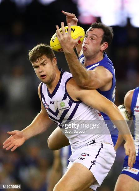 Todd Goldstein of the Kangaroos and Sean Darcy of the Dockers compete for the ball during the round 16 AFL match between the North Melbourne...