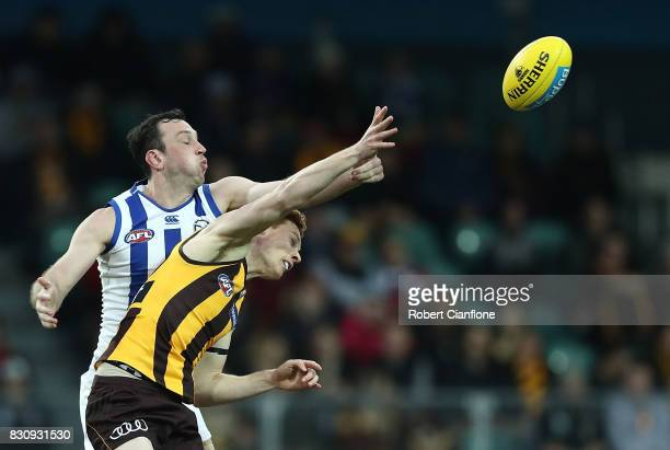 Todd Goldstein of the Kangaroos and Tim O'Brien of the Hawks compete for the ball during the round 21 AFL match between the Hawthorn Hawks and the...