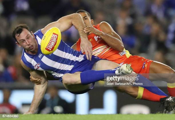 Todd Goldstein of the Kangaroos is tackled during the round six AFL match between the North Melbourne Kangaroos and the Gold Coast Suns at Etihad...