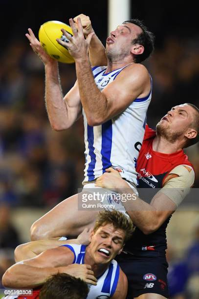 Todd Goldstein of the Kangaroos marks infront of Tom McDonald of the Demons during the round nine AFL match between the Melbourne Demons and the...