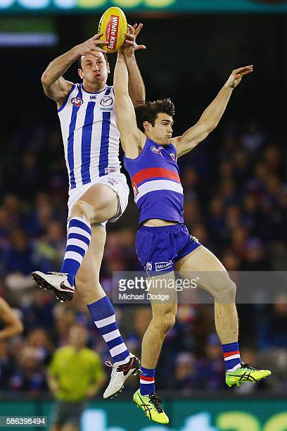 Todd Goldstein of the Kangaroos marks the ball against Easton Wood of the Bulldogs during the round 20 AFL match between the Western Bulldogs and the...