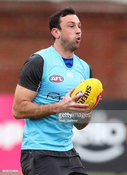 Todd Goldstein of the Kangaroos runs with the ball during a North Melbourne Kangaroos AFL training session at Arden Street Ground on June 29 2017 in...