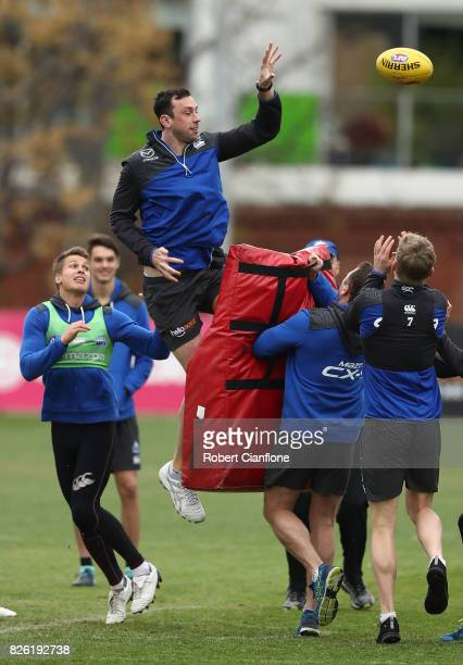 Todd Goldstein of the Kangaroos taps the ball away during a North Melbourne Kangaroos AFL training session at Arden Street Ground on August 4 2017 in...