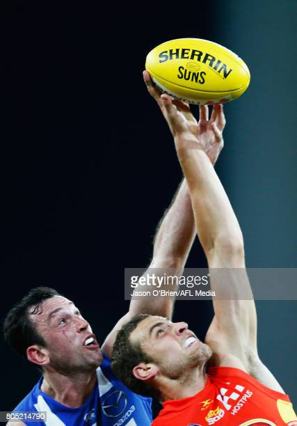 Todd Goldstein of the roos battles with Jarrod Witts of the Suns during the round 15 the Gold Coast Suns and the North Melbourne Kangaroos at...