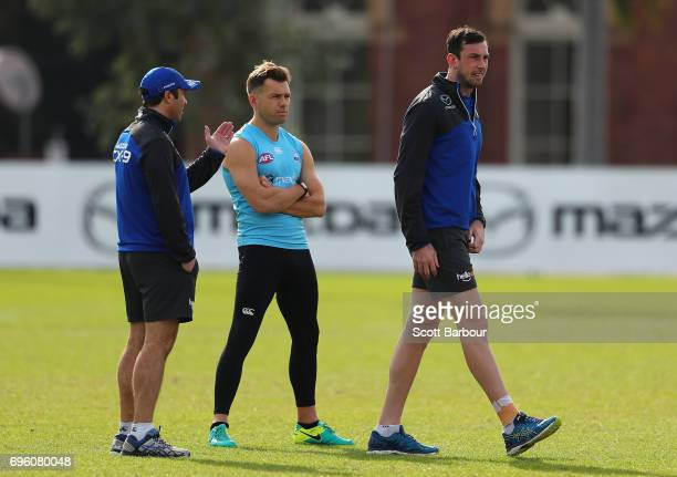 Todd Goldstein Shaun Higgins of the Kangaroos and Brad Scott coach of the Kangaroos talk during a North Melbourne Kangaroos AFL training session at...