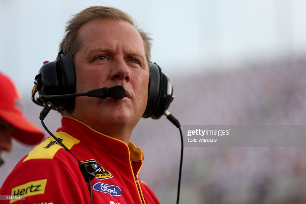 Todd Gordon, crew chief for Joey Logano, driver of the #22 Shell-Pennzoil Ford, stands on the grstands on the gridduring qualifying for the NASCAR Sprint Cup Series Quaker State 400 presented by Advance Auto Parts at Kentucky Speedway on June 27, 2014 in Sparta, Kentucky.