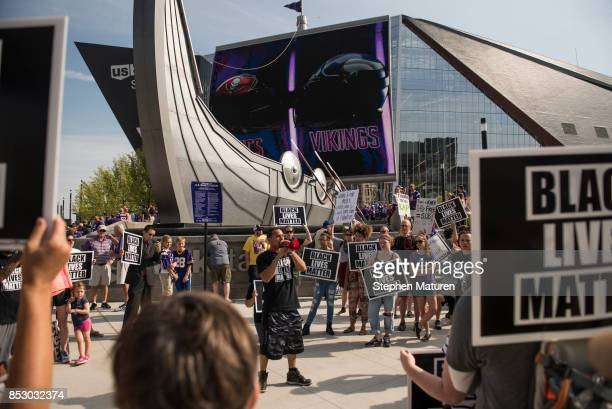 Todd Gramenz of Black Lives Matter St Paul leads a chant outside the Minnesota Vikings game on September 24 2017 at US Bank Stadium in Minneapolis...