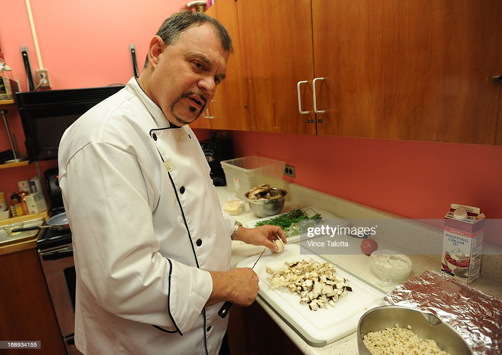 Todd Guerrin B.C. chef in the test kitchen , cooking Maple Cured Salmon dish, that he makes frequently for the fancy people who ride the rocky mountain train he cooks on in Toronto on May 14, 2013 Cutting and cooking mushroom ,then adding cream .Adding the barley to cook with the mixture. adding salt ,peeper and smoked maple sugar to the salmon. adding dijon,grainy mustard,cedar jelly, salt,pepper, oil and red wine vinegar for the plating of the cooked salmon.