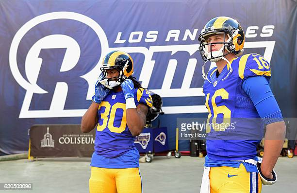 Todd Gurley and Jared Goff of the Los Angeles Rams look on before the game against the San Francisco 49ers at Los Angeles Memorial Coliseum on...