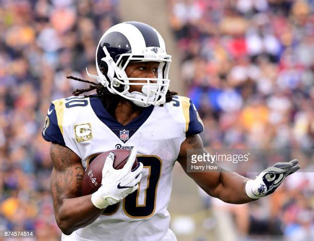 Todd Gurley II of the Los Angeles Rams carries the ball against the Houston Texans at Los Angeles Memorial Coliseum on November 12 2017 in Los...