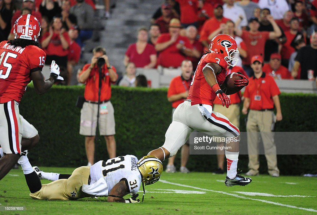 <a gi-track='captionPersonalityLinkClicked' href=/galleries/search?phrase=Todd+Gurley&family=editorial&specificpeople=9688396 ng-click='$event.stopPropagation()'>Todd Gurley</a> #3 of the Georgia Bulldogs breaks the tackle of Javon Marshall #31 of the Vanderbilt Commodores for a touchdown at Sanford Stadium on September 22, 2012 in Athens, Georgia.