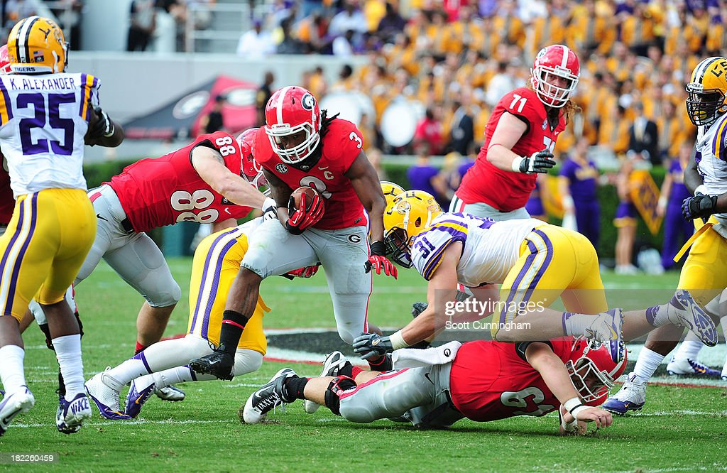 <a gi-track='captionPersonalityLinkClicked' href=/galleries/search?phrase=Todd+Gurley&family=editorial&specificpeople=9688396 ng-click='$event.stopPropagation()'>Todd Gurley</a> #3 of the Georgia Bulldogs carries the ball against the LSU Tigers at Sanford Stadium on September 28, 2013 in Athens, Georgia.