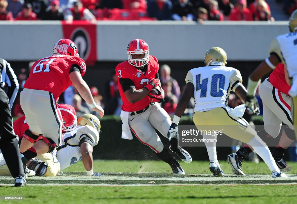 <a gi-track='captionPersonalityLinkClicked' href=/galleries/search?phrase=Todd+Gurley&family=editorial&specificpeople=9688396 ng-click='$event.stopPropagation()'>Todd Gurley</a> #3 of the Georgia Bulldogs carries the ball against the Georgia Tech Yellow Jackets at Sanford Stadium on November 24, 2012 in Athens, Georgia.