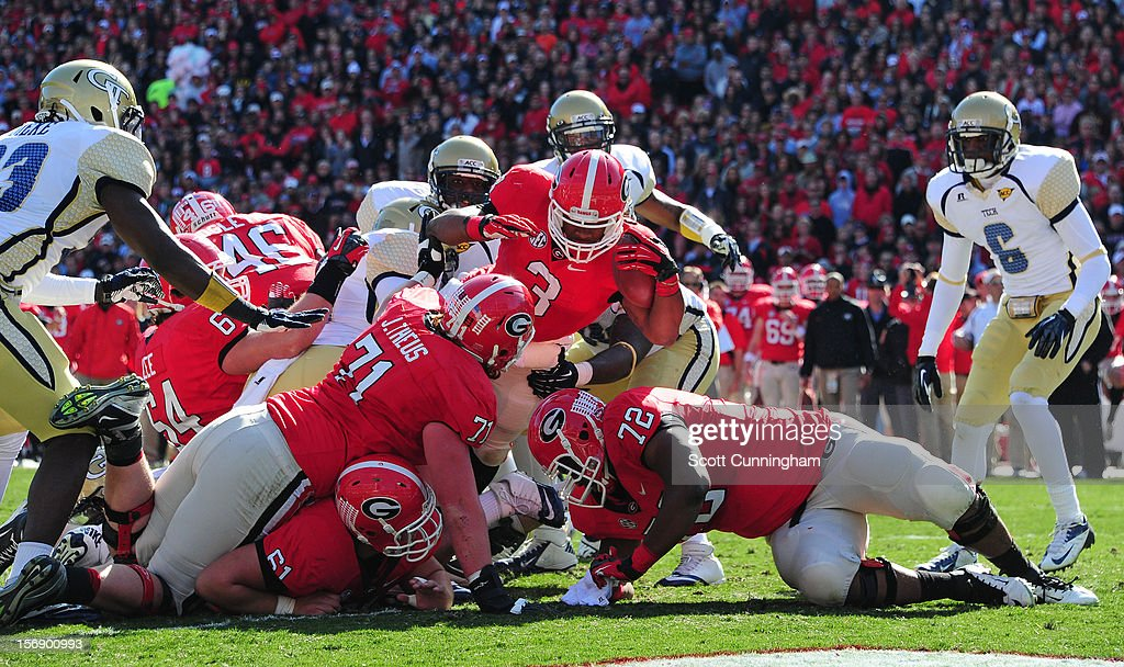 <a gi-track='captionPersonalityLinkClicked' href=/galleries/search?phrase=Todd+Gurley&family=editorial&specificpeople=9688396 ng-click='$event.stopPropagation()'>Todd Gurley</a> #3 of the Georgia Bulldogs carries the ball for a touchdown against the Georgia Tech Yellow Jackets at Sanford Stadium on November 24, 2012 in Athens, Georgia.