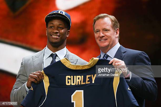 Todd Gurley of the Georgia Bulldogs holds up a jersey with NFL Commissioner Roger Goodell after being picked overall by the St Louis Rams during the...