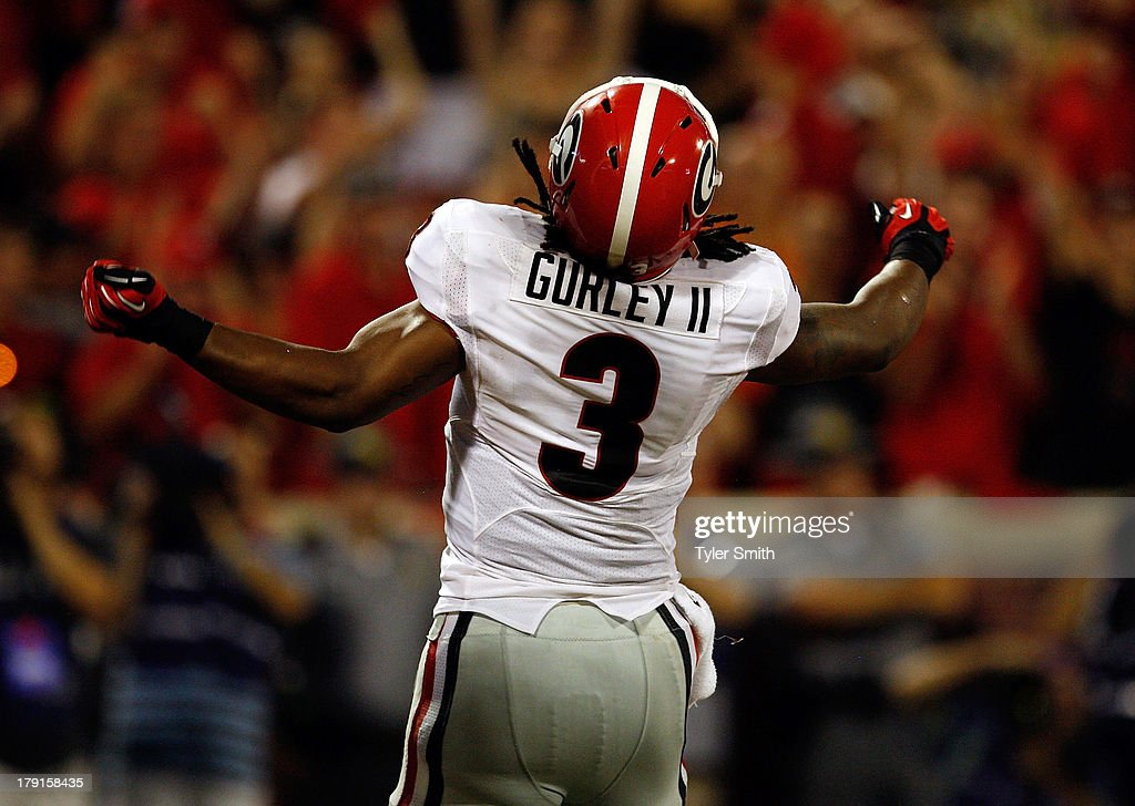 <a gi-track='captionPersonalityLinkClicked' href=/galleries/search?phrase=Todd+Gurley&family=editorial&specificpeople=9688396 ng-click='$event.stopPropagation()'>Todd Gurley</a> #3 of the Georgia Bulldogs reacts after scoring a touchdown during the game against the Clemson Tigers at Memorial Stadium on August 31, 2013 in Clemson, South Carolina. Clemson defeated Georgia 38-35.