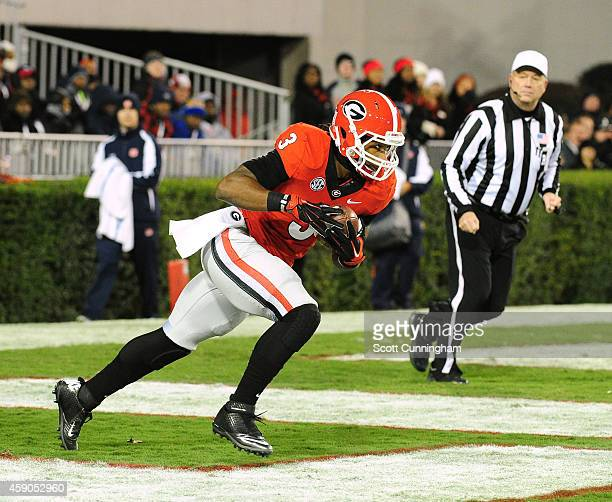 Todd Gurley of the Georgia Bulldogs returns a kickoff for a 103yard touchdown against the Auburn Tigers at Sanford Stadium on November 15 2014 in...