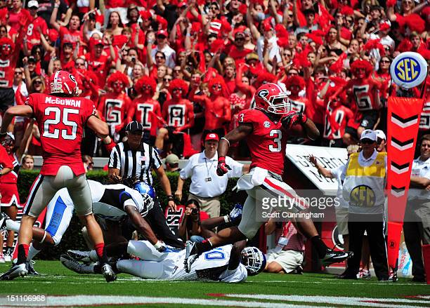 Todd Gurley of the Georgia Bulldogs rushes for a first quarter touchdown against the Buffalo Bulls at Sanford Stadium on September 1 2012 in Athens...