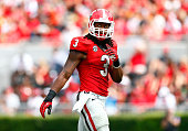 Todd Gurley of the Georgia Bulldogs walks off the field between downs against the Tennessee Volunteers at Sanford Stadium on September 27 2014 in...