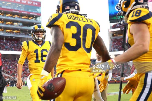 Todd Gurley of the Los Angeles Rams celebrates with Jared Goff after scoring against the San Francisco 49ers during their NFL game at Levi's Stadium...