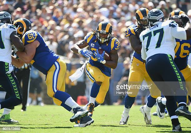 Todd Gurley of the Los Angeles Rams cuts throughthe hole during the second quarter of the home opening NFL game against the Seattle Seahawks at Los...