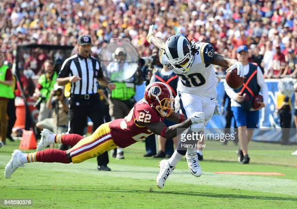 Todd Gurley of the Los Angeles Rams evades Deshazor Everett of the Washington Redskins during the third quarter at Los Angeles Memorial Coliseum on...